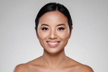 Beauty portrait of a beautiful half naked asian woman