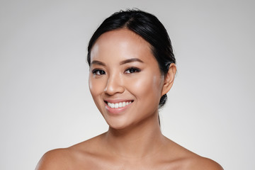 Beauty portrait of a smiling half naked asian woman