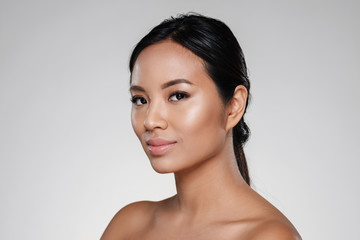 Beauty portrait of an attractive half naked asian woman