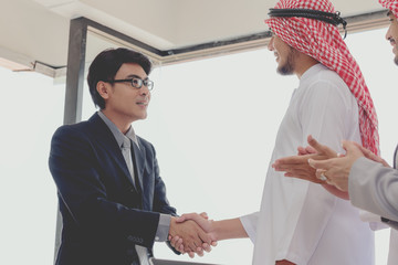 business success concept : arab business people meeting team partner ,happy hand shake communication