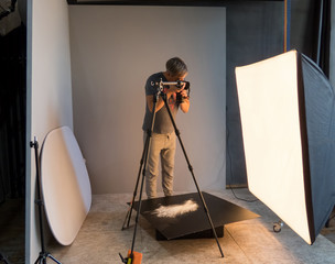 photographer working in the studio. unintended photography