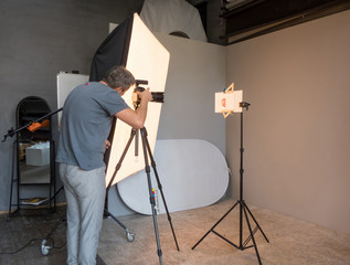 the work process of the photographer in the background of the lightbox. unintended photography