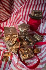 pecan fudge squares on Christmas wrapping paper