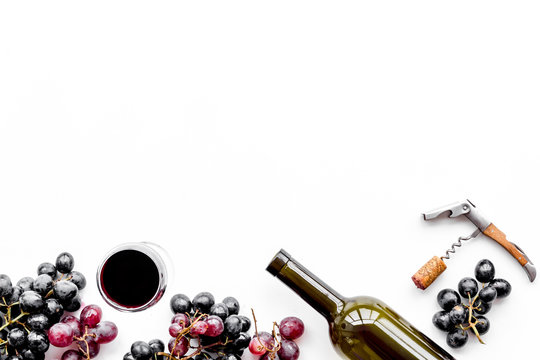 Open the wine. Corkscrew near bottle, glass, grape on white background top view copyspace
