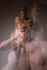 Male portrait of a dancer with a double exposure in the studio