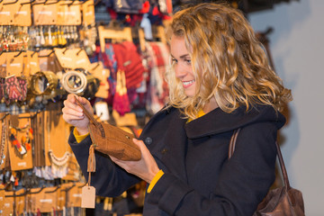 happy woman enjoys in clothing shop