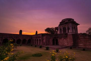 Mandu India, afghan ruins of islam kingdom, mosque monument and muslim tomb. Colorful sky at sunrise, Ashrafi Mahal.
