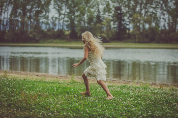 scared child running away in the nature at dark atmosphere
