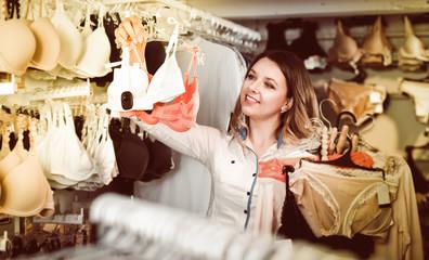 Customer woman in underwear shop