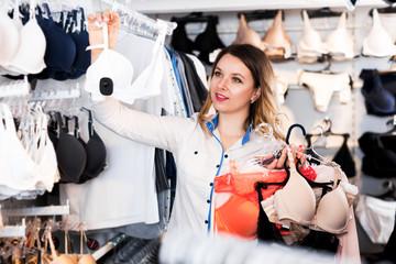 Female customer deciding on pretty bra