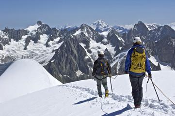 Climbers make their way along a ridge near the Aiguille du Midi on Mont Blanc Chamonix, France