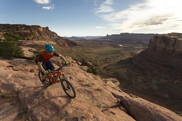 Front view of man biking during daytime in Moab, Utah, USA