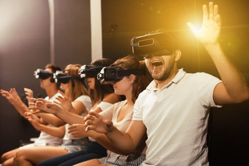 Guy with friends wearing VR headset
