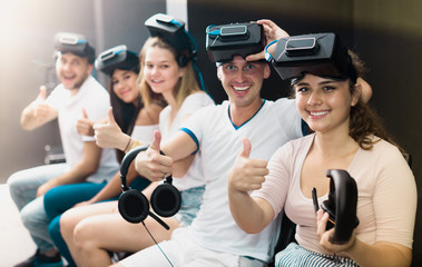 Group of friends are wearing virtual reality goggles