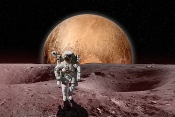 Astronaut on moon surface. Mars in background. Elements of this image furnished by NASA