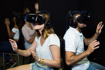 five people immersed in virtual reality with  3d glasses