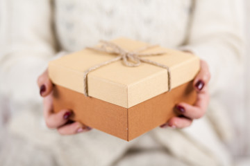 Present box in woman's hands
