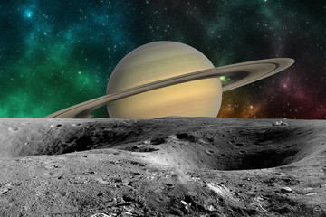 Planet Saturn from Saturn moon surface. Elements of this image furnished by NASA