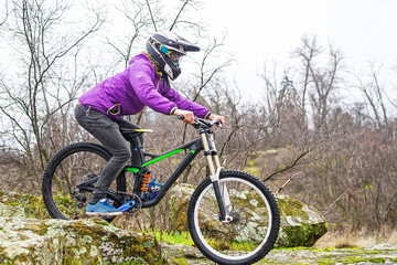 Enduro Cyclist Riding the Mountain Bike on the Rocky Trail.