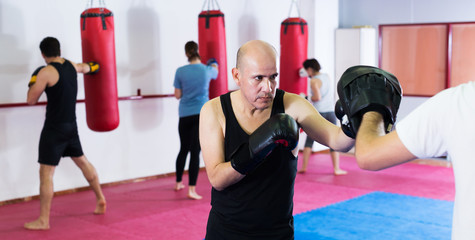 Sportsmen competing in boxing gloves