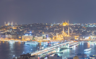 ISTANBUL - SEPTEMBER 2014: Aerial view of city skyline at night. The city attracts 20 million people annually