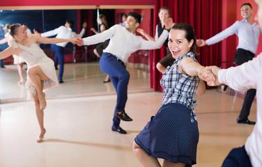 Adult dancing couples enjoying active swing
