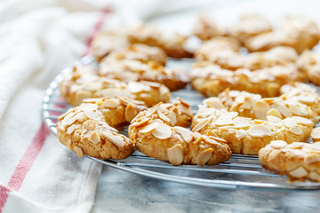 Almond crescent cookies on a metal grid.