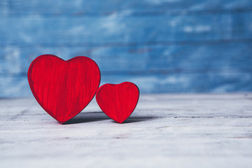Love hearts on wooden texture background. Valentines day card concept. Heart for Valentines Day Background.