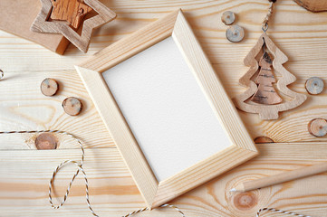 Christmas background with a wooden frame and a star and tree. Flat lay, top view photo mockup, with space for your text