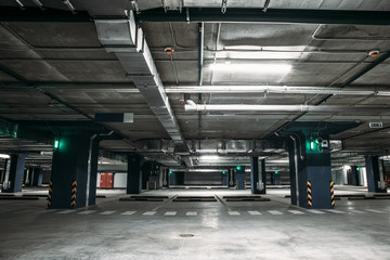Empty car parking garage underground interior inside in apartment building or in mall or supermarket