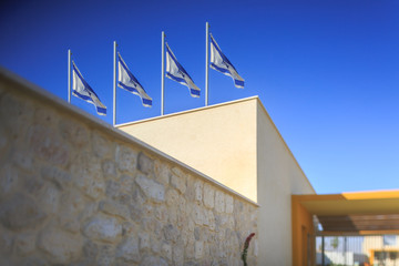 Four flags of Israel on building