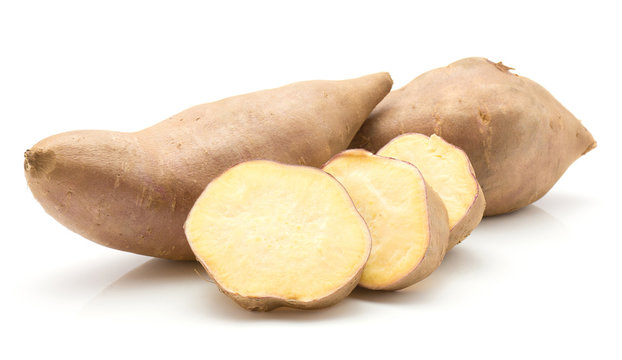 Two sweet potato and three slices isolated on white background.