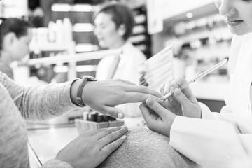 Manicurists giving manicure