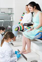 Women enjoying pedicure