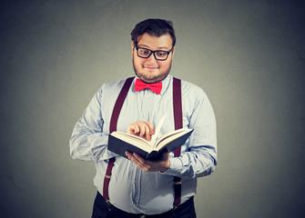 Surprised man enjoying book
