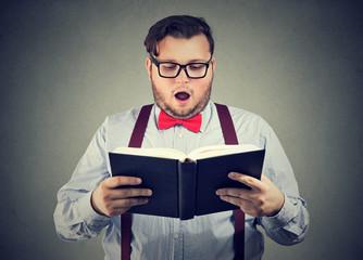 Man reading interesting book