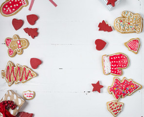 Christmas gingerbread cookies on white wood table. Top view