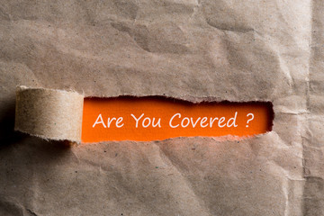 Are you covered - question written on orange paper in brown envelope
