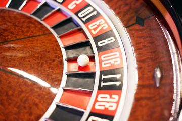 casino roulette, ball on red. The concept of gambling in roulette
