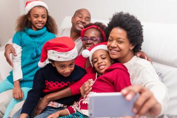 Black family taking a christmas selfie