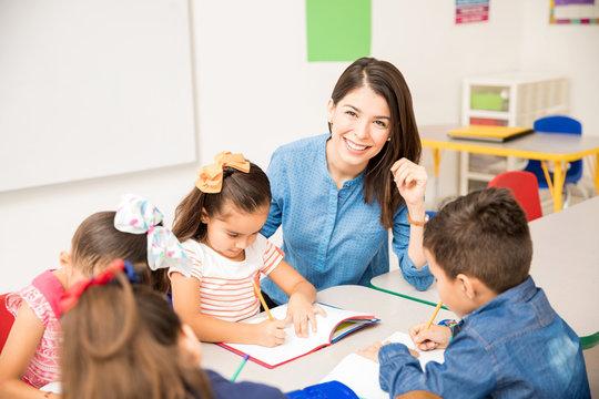Beautiful preschool teacher during class