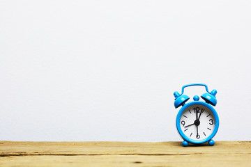 Concept of time management with blue clock isolated on white background