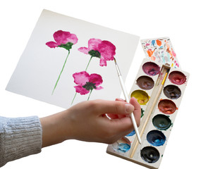 Watercolors, painting of beautiful pink flowers, hand holding a brush, isolated on a white background