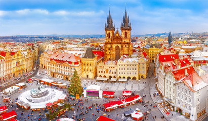 Prague. Panoramic aerial view of Chrismtas market. Seasonal winter scenery in sunny day.