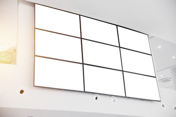 wall LCD display screen panel in modern office building with clipping path at blank screen