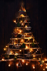 creative handmade christmas tree illuminated in the dark
