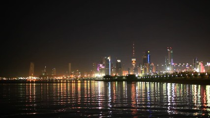 Wall Mural - Skyline of Kuwait City illuminated at night. View from the Shuwaikh beach