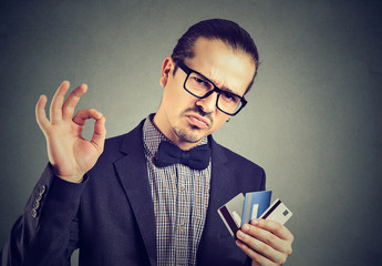 Confident businessman with credit cards