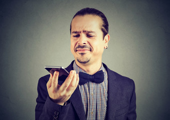 Man dissatisfied with new smartphone