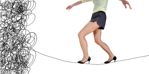 a woman walking on a tightrope made of string for the concept of risk or danger in the business corporate world isolated on a white background